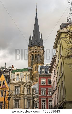 AACHEN/ GERMANY - NOVEMBER 20, 2016: Tower of Aachen Cathedral rises above all other buildings in the city centre decorated for Christmas