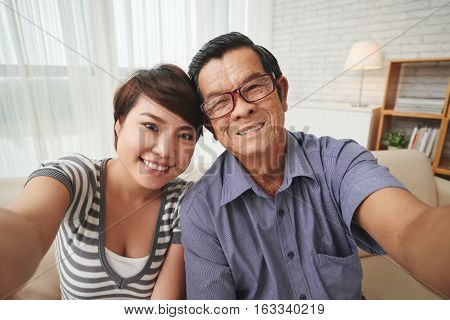 Selfie of Vietnamese grandfather and his granddaughter
