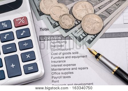 Save money concept - utility bill with pen calculator and us dollar