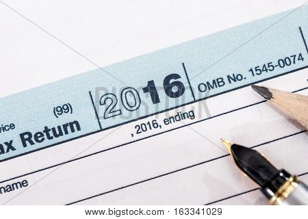 2017 tax form 1040 with a pen.