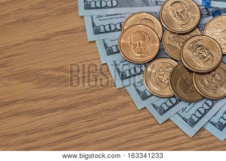 us coins and One hundred dollar on desk