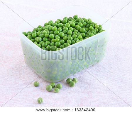 Healthy food cooked peas in a freezer safe box.