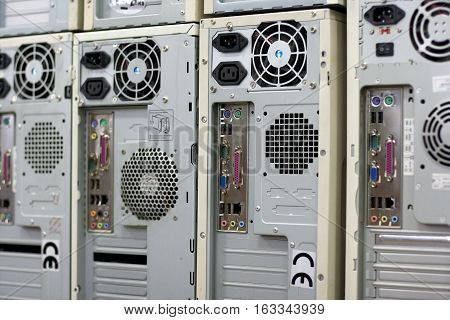 Rows of backplanes of standard computer cases with various slots