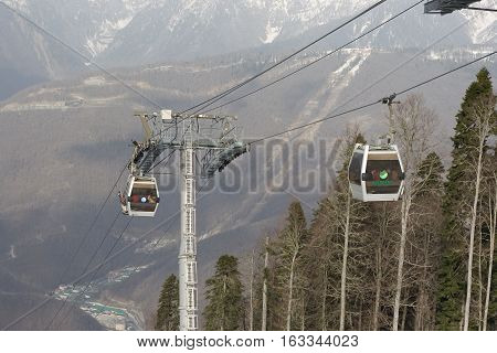 Cabins and a deep mountain view of a cable way during Olympics 2014