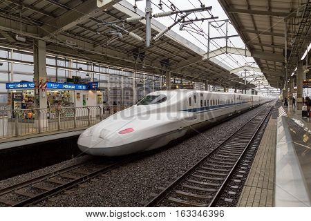 Kyoto, Japan - December 16, 2014: A Shinkansen high speed train arriving at the train station
