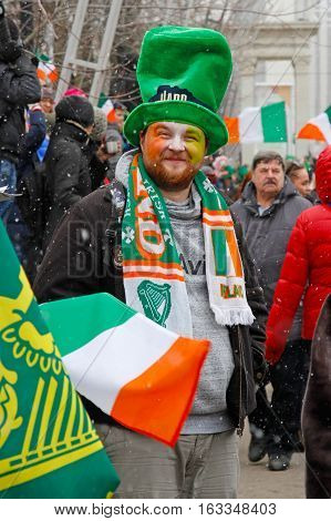 Moscow Russia - March 19 2016: Participant in the Irish hat and scarf at the St. Patrick's Day Parade in the Irish hat in the park Sokolniki in Moscow