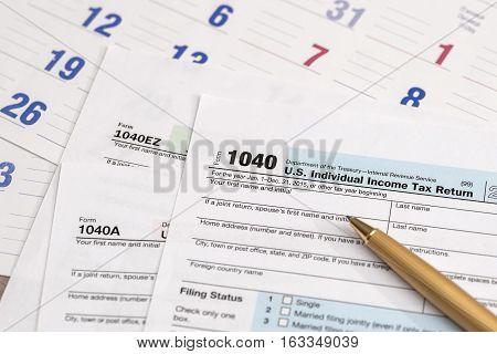 us 1040 tax form with a calendar