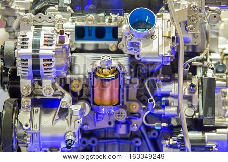 Closeup to new colorful car's engine in motorshow.