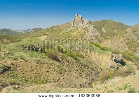 Beautiful spring Crimean landscape with Frog mountain near Sudak town on a Black Sea shore.