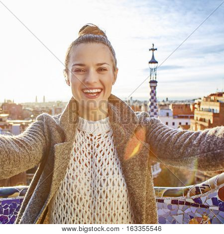 Tourist Woman At Guell Park In Barcelona, Spain Taking Selfie