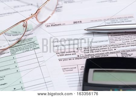 1040 us tax form with a calculator