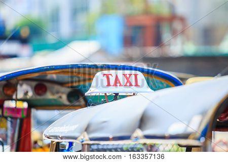 Closeup to banner of taxi tuktuk Bangkok, Thailand.