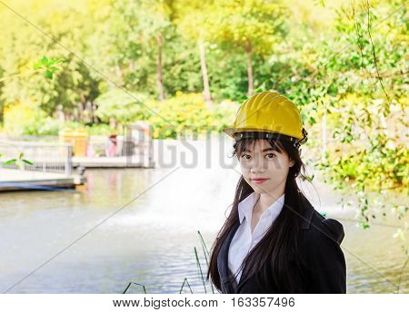 Asian woman engineer inspect her job about movement water of water turbines waste water treatment by Aerator