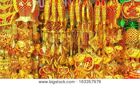 Various of Chinese red decorations hanging for sell at the market. With greeting word wish you have a good year, good health, good luck and rich.