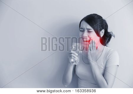 woman drink water with sensitive teeth asian