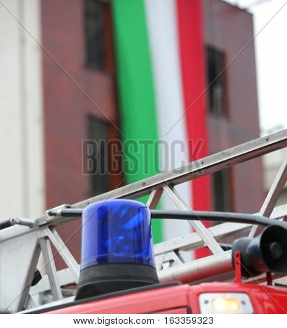 Siren Of The Fire Truck And The Italian Flag On The Background