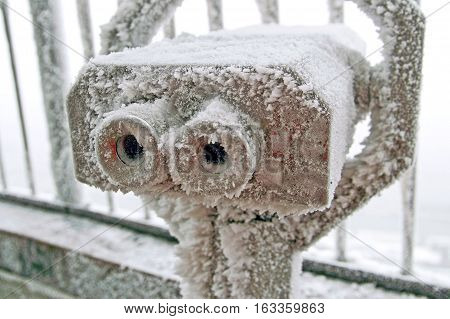 Coin operated binoculars for observation of Vienna covered by snow and ice in the winter