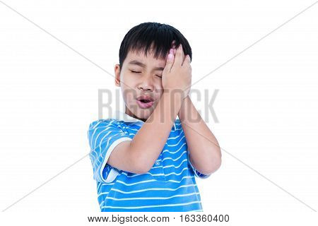 Closeup of asian child have a headache his hand on temple emotion feeling sign. Isolated on white background. Boy with a painful gesture. Negative human emotion facial expression feeling reaction.