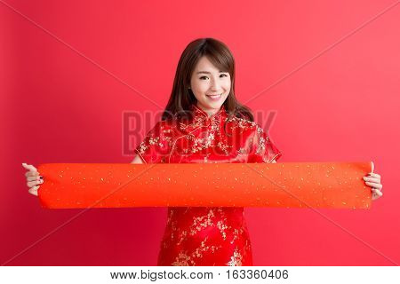 beauty woman wear cheongsam and show couplets with chinese new year