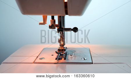 sewing machine and item of clothing closeup