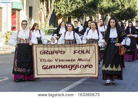 QUARTU S.E., ITALY - September 17, 2016: Parade of Sardinian costumes and floats for the grape festival in honor of the celebration of St. Helena. - Sardinia - Parade of folk group Efisio Vincenzo Melis Guamaggiore