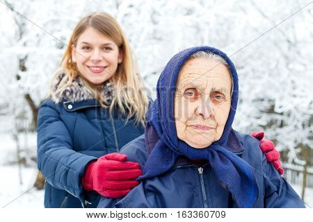 Portrait of a cute old lady with her granddaughter