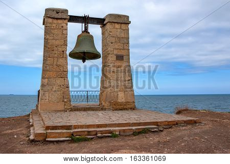 Signal bell in ruins of ancient Chersonesus Tauric archaeological park in Sevastopol, Crimea