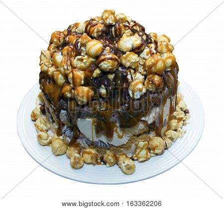 Ice cream cake with popcorn drizzled with chocolate and toffee sauce on an isolated white background with a clipping path