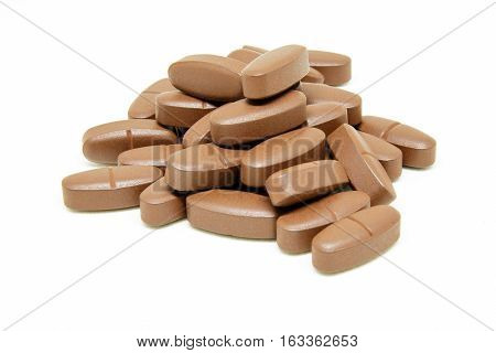 Many of Vitamin B tablets on white background.