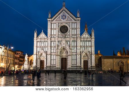 Tourists On Piazza Santa Croce In Rainy Night