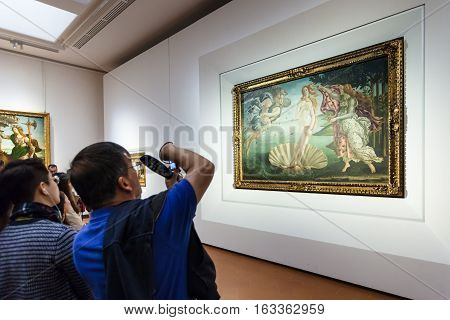 Visitor Take Photo In Room Of Uffizi Gallery
