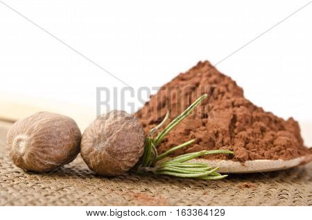 Nutmeg With A Sprig Of Rosemary And Cacao Powder