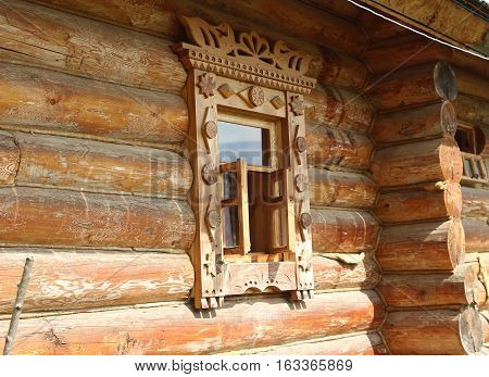 A window with decorative wooden carvings in a russian style
