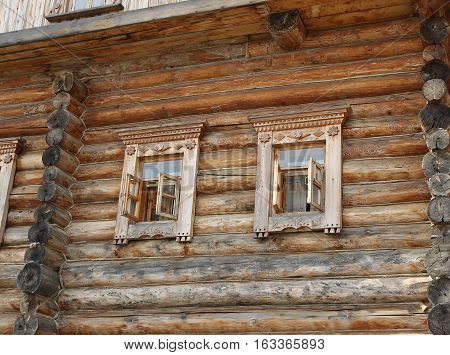 Ornated windows in a traditional belarussian log house