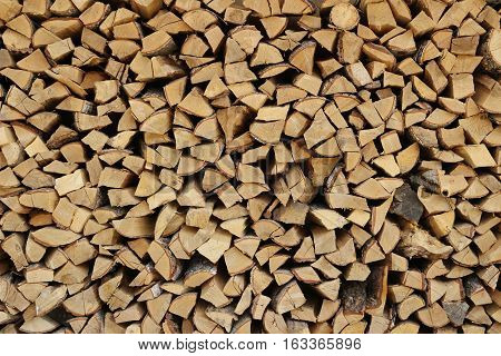 A background picture of a pile of chopped firewood