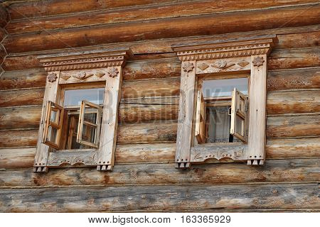 Decorated wooden windows with traditional carving ornament, Moscow, Ethnomir park, June 2016