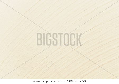 Light yellow plastering background with curving structure