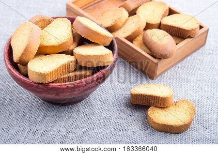 Pieces Of Rusk In The Old Brown Wooden Crockery