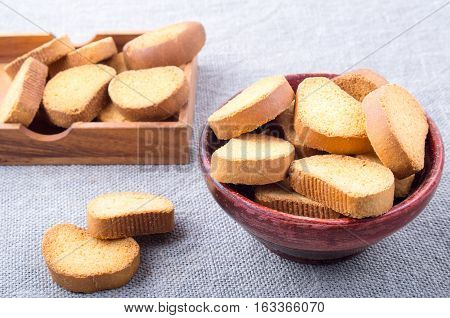Slices Of Dried Bread In An Old Brown Wooden Crockery