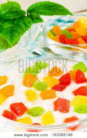 View Close-up On Oatmeal With Colorful Candied Fruits