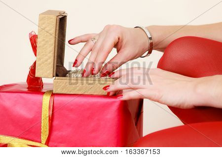 Female Hands Opening Golden Gift Box With Jewel Pearls