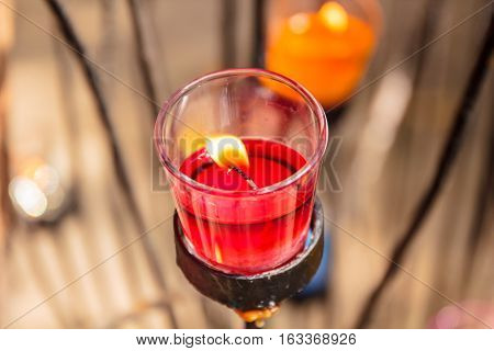 Beautiful colorful red scented candles in glass.