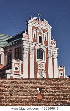 Baroque Catholic Church behind medieval defensive wall in Poznan