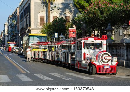 Catania, Italy - September 13, 2015: Excursion steam train in city center of Catania, Sicily, Italy