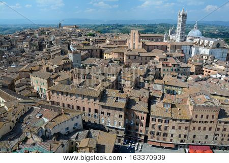 Siena Italy - September 8 2016: Aerial view of medieval Siena city in Tuscany Italy. Unidentified people visible.