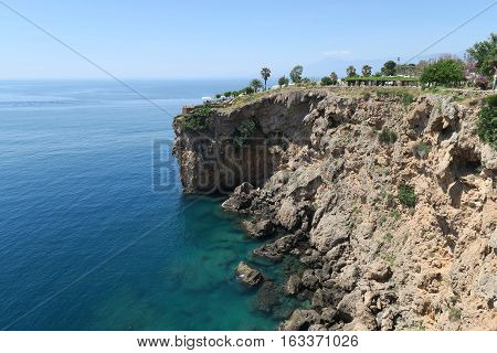 Cliffs of Antalya near Duden Waterfall. View from the top of the 40m high Cliffs at the Mediterranian Sea