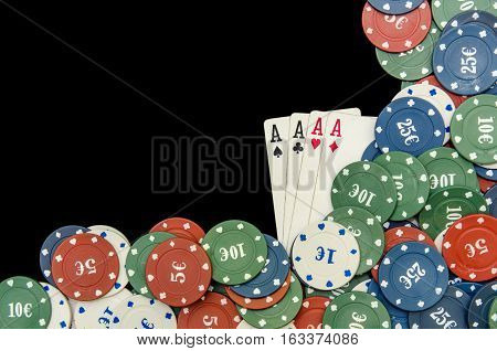 play cards and poker chips on black background
