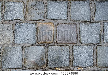 old  wet cobbles for background or texture