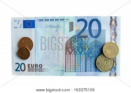 twenty euro banknote with a coins isolated