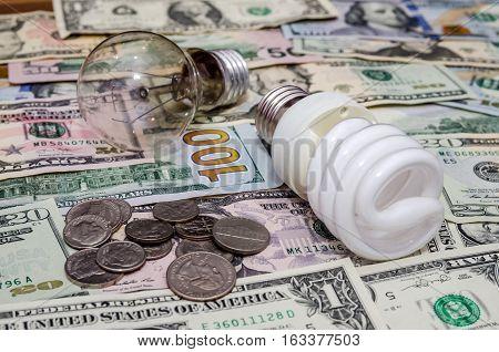 Fluorescent Light bulb on us dollar background
